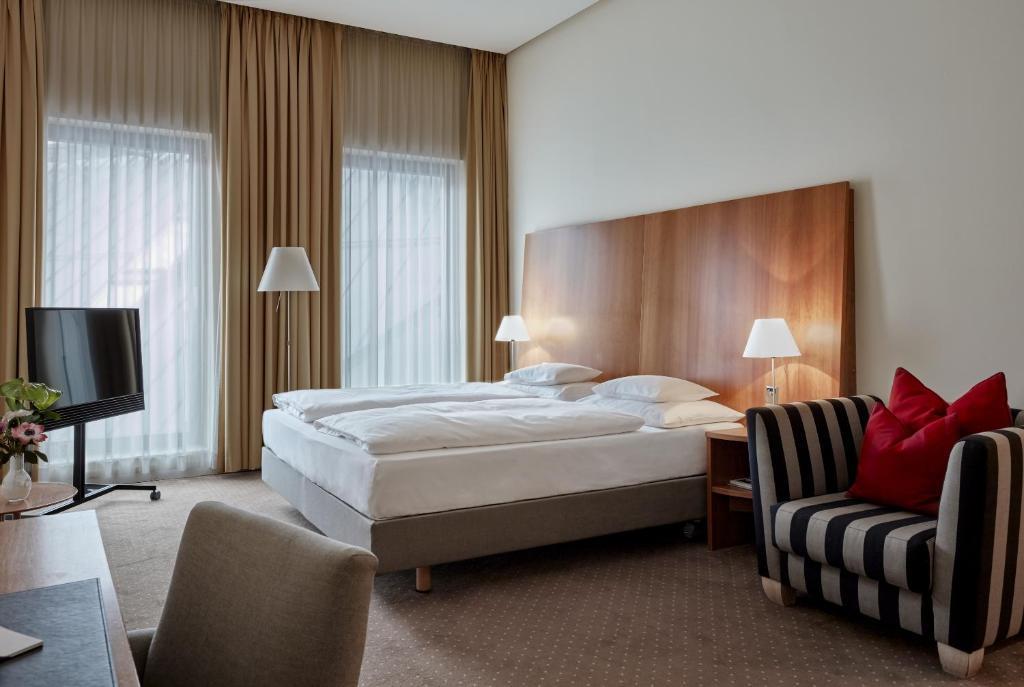 سرير أو أسرّة في غرفة في فندق داس تريست