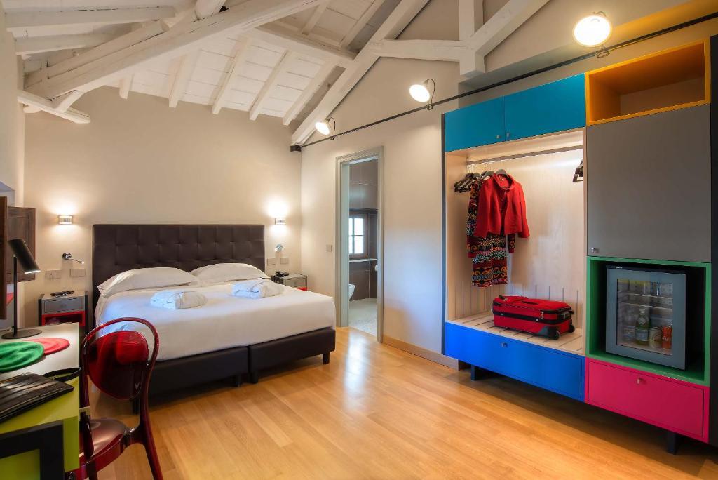 Cama o camas de una habitación en Albergo Etico Roma