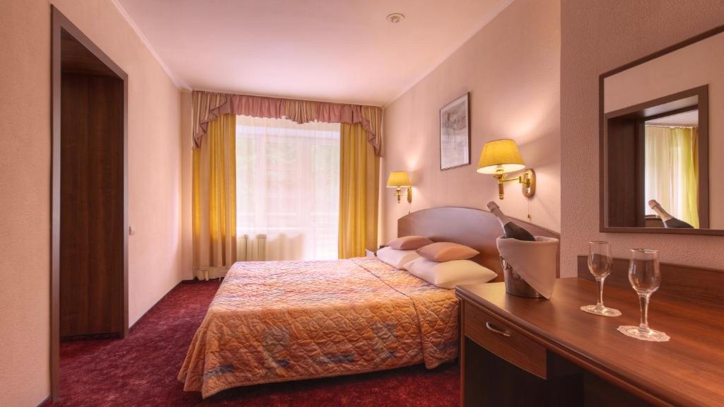 Кровать или кровати в номере Загородный комплекс Тропикана Парк