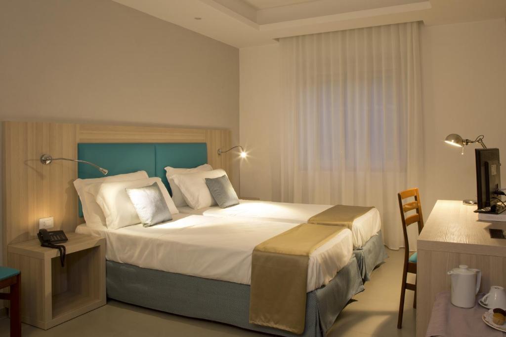 Letto o letti in una camera di American Hotel
