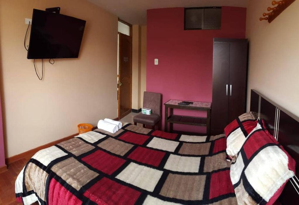 A bed or beds in a room at Real Cusco