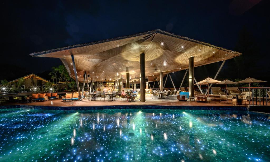 The swimming pool at or near Kalima Resort and Villas Khao Lak
