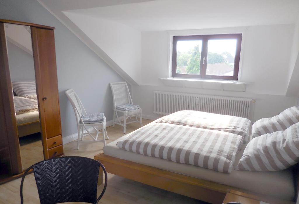 Ein Bett oder Betten in einem Zimmer der Unterkunft Bremer Bio Bleibe