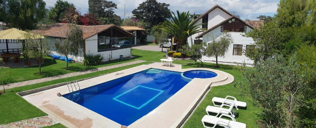 A view of the pool at Hostería Country House Quinta Carlota or nearby