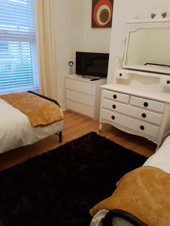 Giường trong phòng chung tại Barrington House