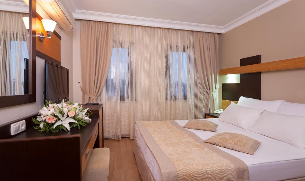 Krevet ili kreveti u jedinici u okviru objekta Kandelor Hotel