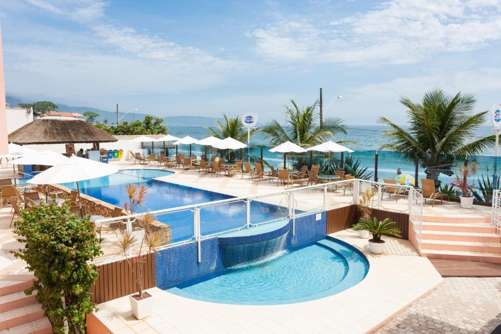 The swimming pool at or near Pousada Vila do Coral