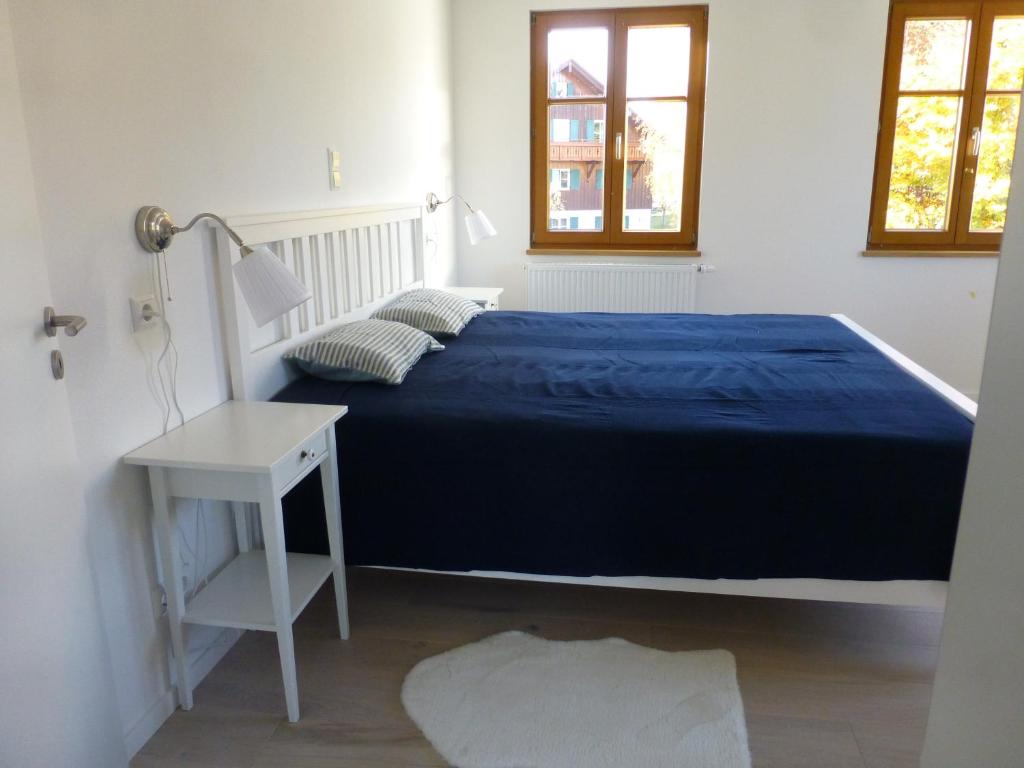 A bed or beds in a room at Ferienwohnung Hochgrat