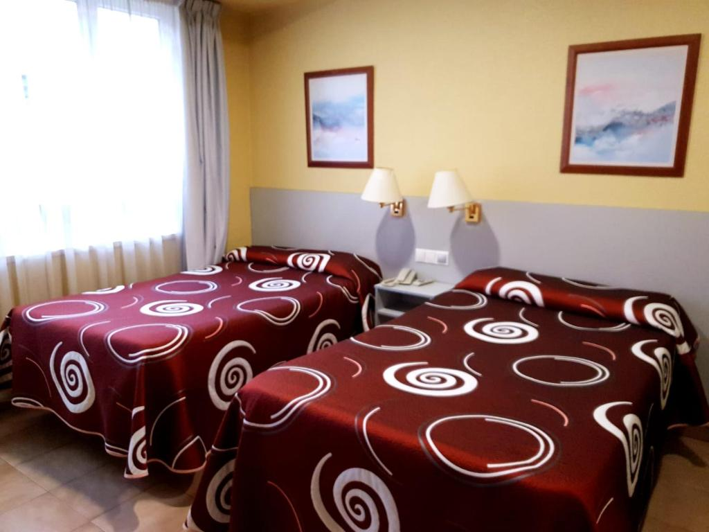 A bed or beds in a room at Hotel Patilla