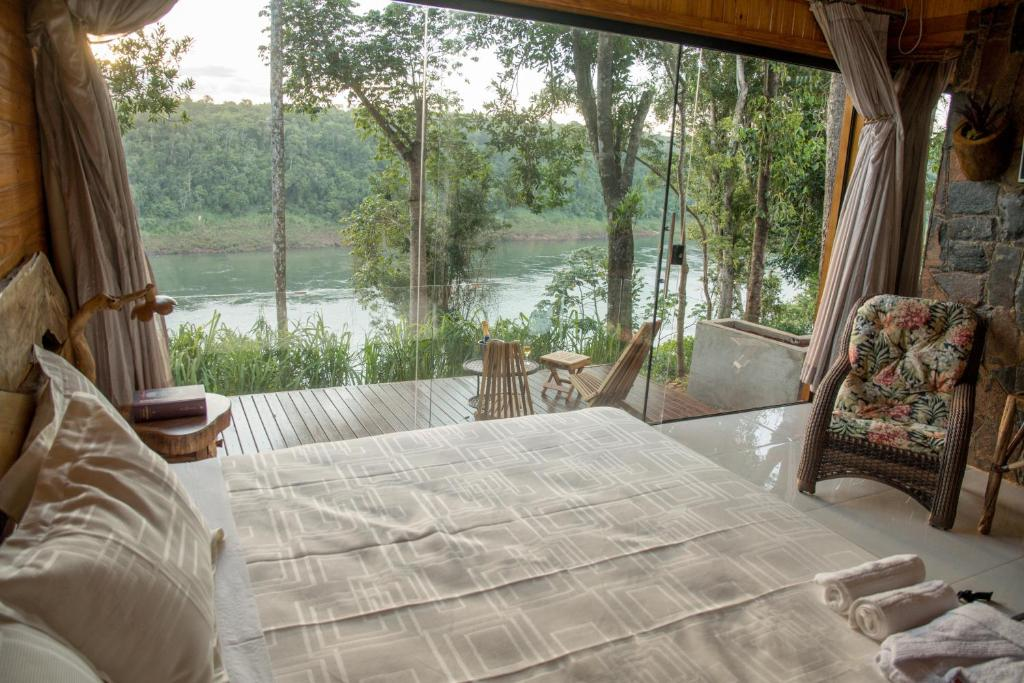A bed or beds in a room at Tupa Lodge