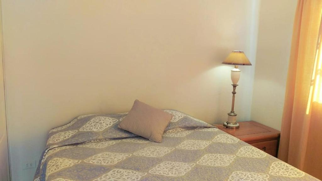 A bed or beds in a room at Trapiche GuestHouse Room2