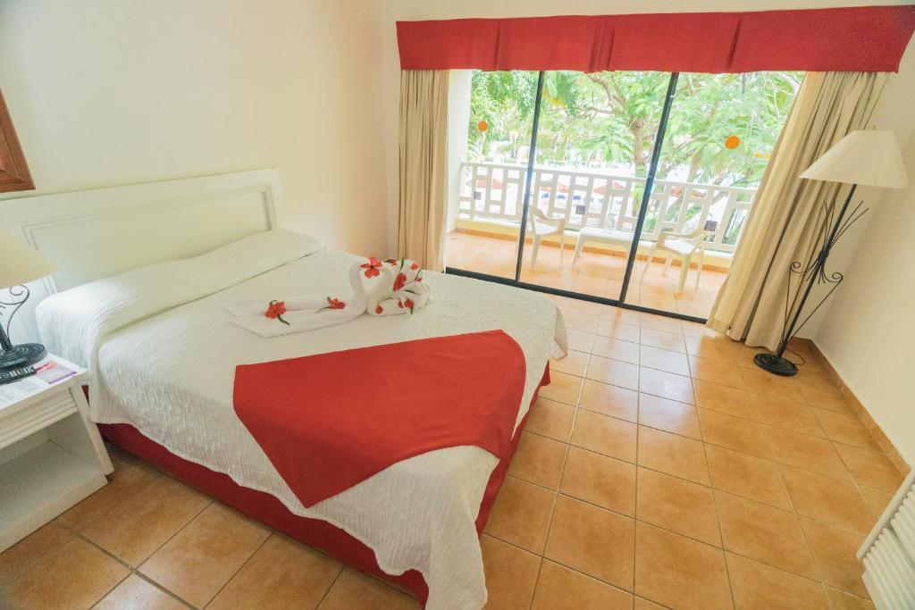 Una cama o camas en una habitación de BelleVue Dominican Bay - All Inclusive