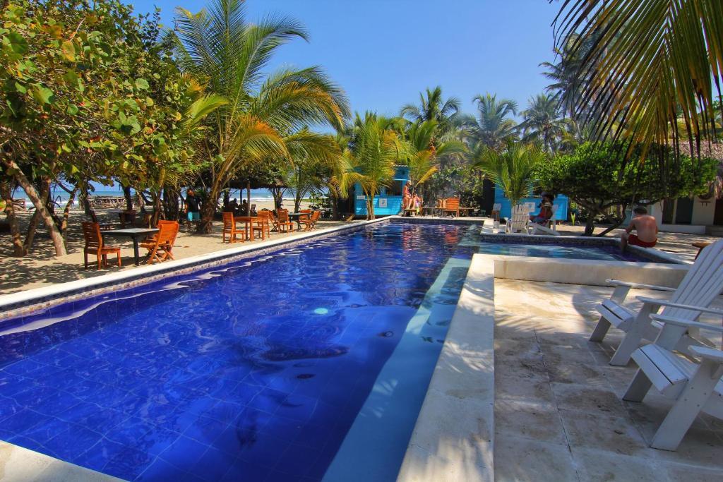 The swimming pool at or near Blue Mango Beach Hotel