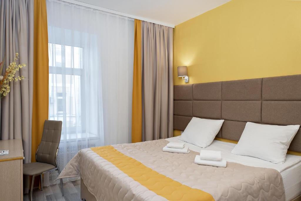 Кровать или кровати в номере Отель Элемент