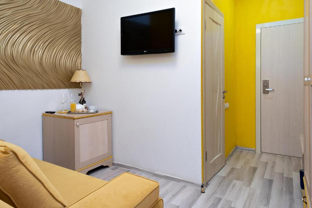 Телевизор и/или развлекательный центр в Отель Элемент