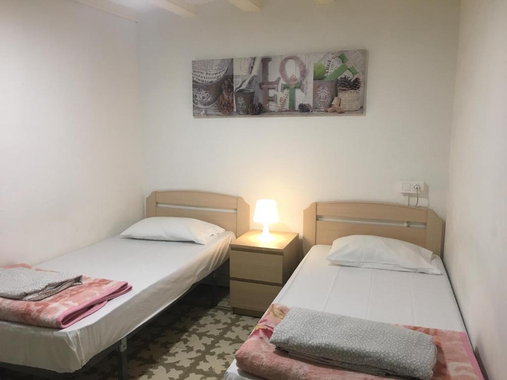 Кровать или кровати в номере Barcelona 4 Fun Hostel