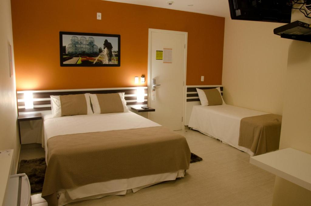 A bed or beds in a room at Bristol Portal do Iguaçu Hotel