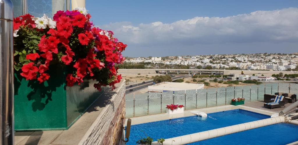 The swimming pool at or near Coral Muscat Hotel and Apartments