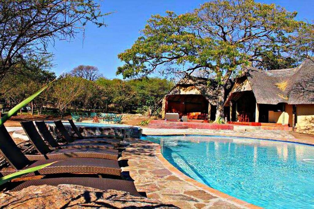 The swimming pool at or near Unlimited Luxury Lodge in Kasane