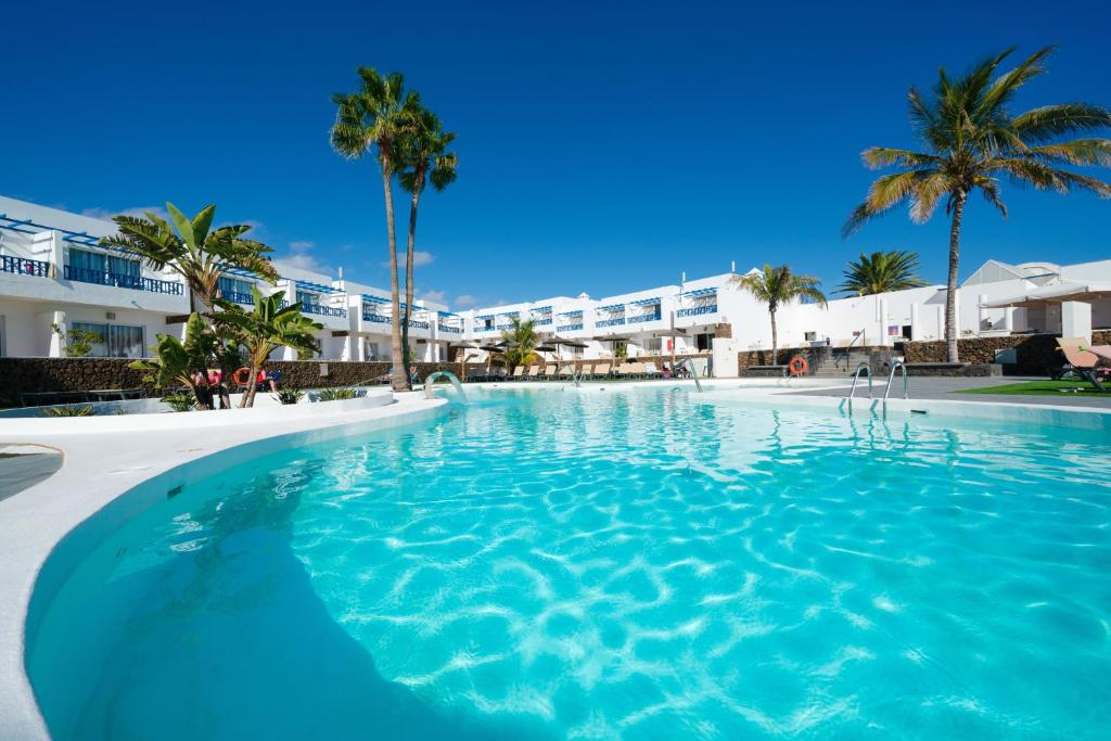 The swimming pool at or near Hotel Club Siroco - Adults Only