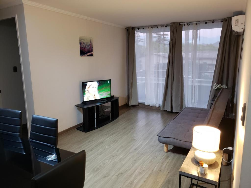 A television and/or entertainment center at Apartamento Los Andes
