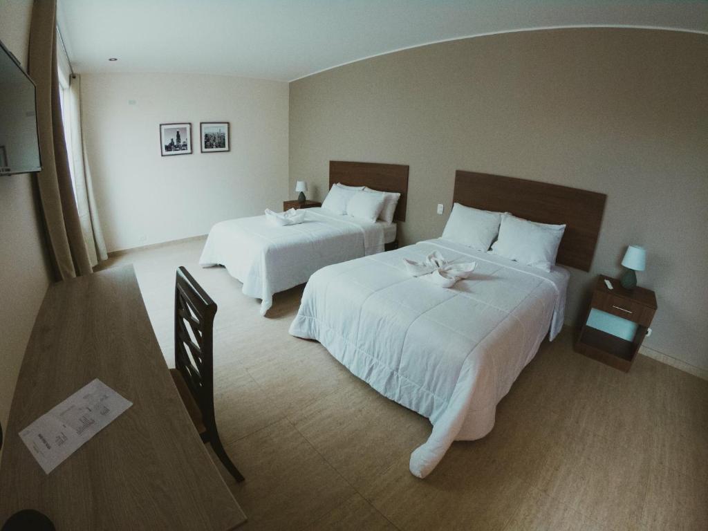 Lova arba lovos apgyvendinimo įstaigoje Villa Oasis