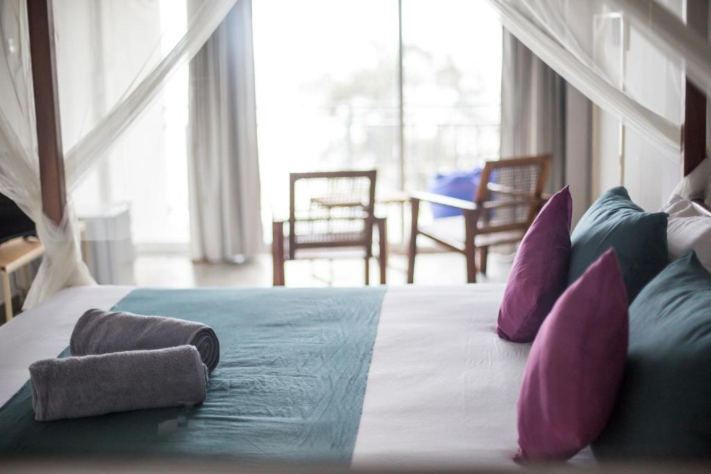 A bed or beds in a room at Happy Go Island - Flamingo Weligama Bay