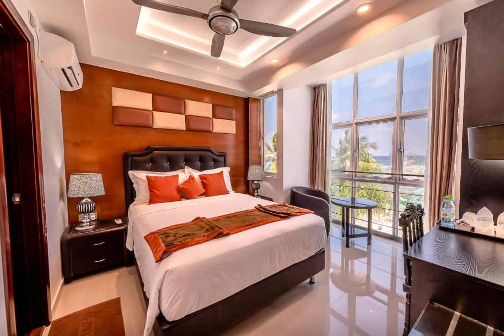 A bed or beds in a room at Rivethi Beach Hotel