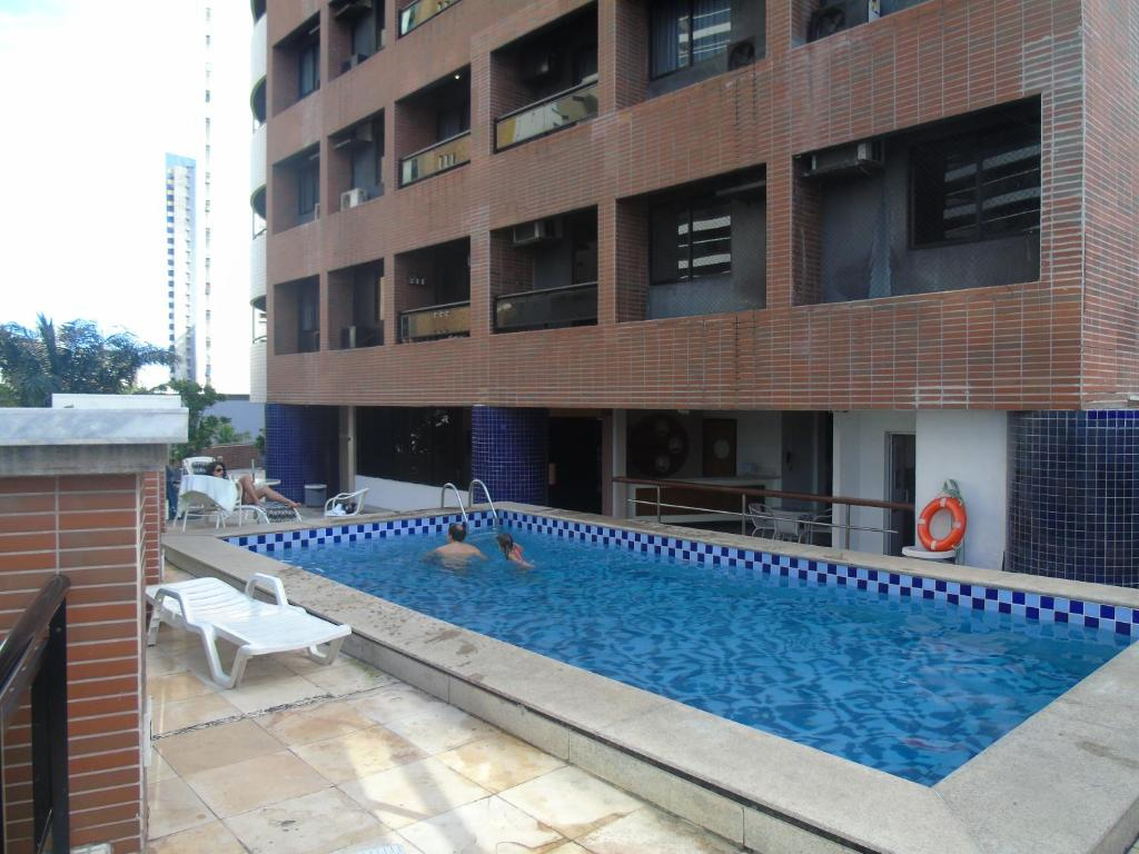 The swimming pool at or close to Flat Mercure 1401 Vista do Mar