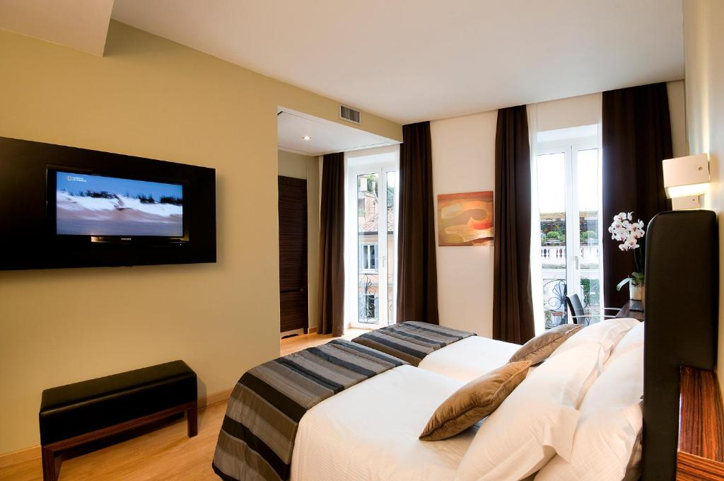 A television and/or entertainment center at Trevi Collection Hotel