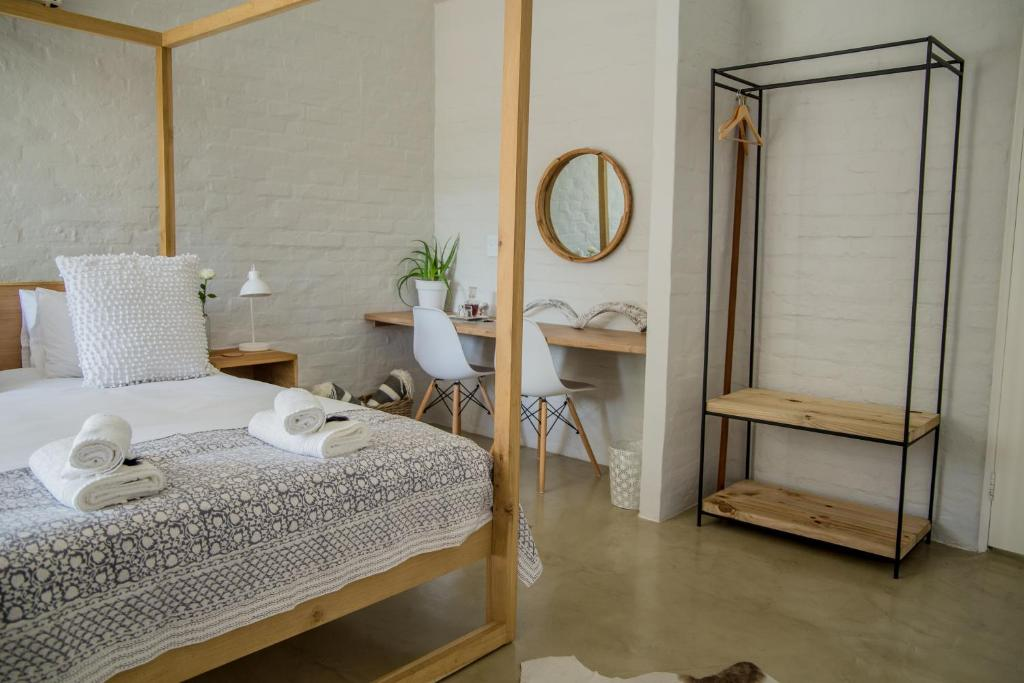 A bed or beds in a room at Raw Karoo Guest House