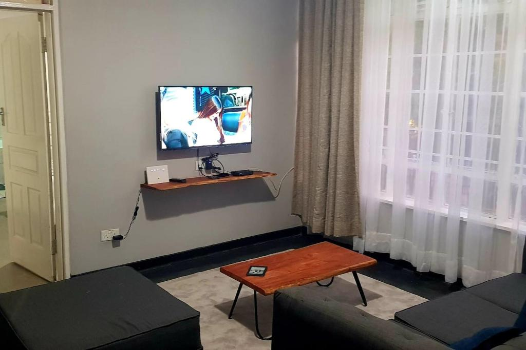 A television and/or entertainment center at Kinghurst, City Apartment