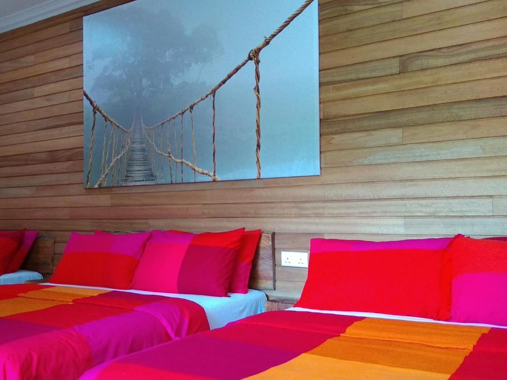 A bed or beds in a room at Naura Roomstay