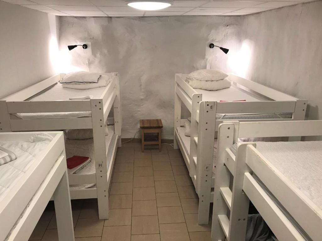 Våningssäng eller våningssängar i ett rum på Hostel Dalagatan