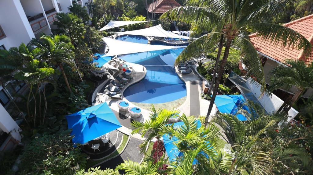 巴厘島沙努爾普萊姆廣場套房酒店游泳池或附近泳池的景觀