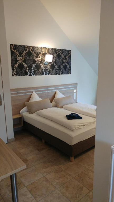A bed or beds in a room at ST Michael Atrona GmbH