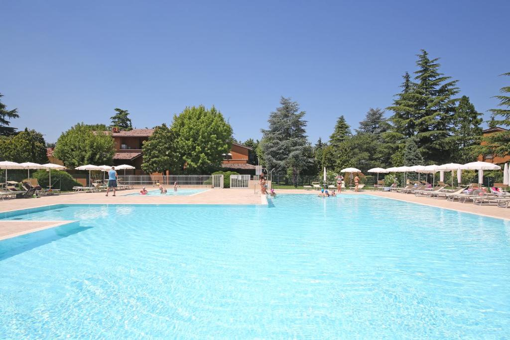 The swimming pool at or near Appartamenti Punta Grò