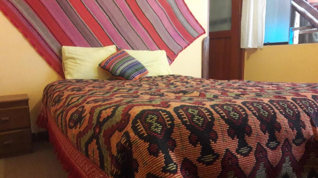 Cama o camas de una habitación en Mamma Cusco Hostel