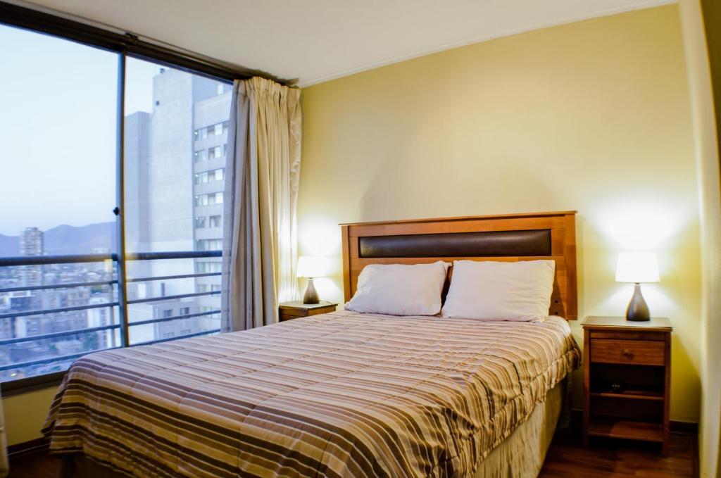 Cama o camas de una habitación en Boulevard Bellas Artes Suites
