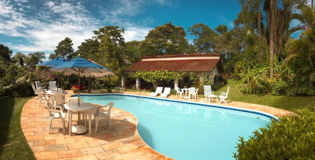 A piscina localizada em Pousada da Gibinha ou nos arredores