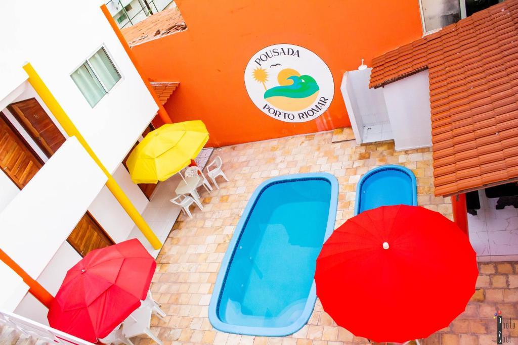 Uma vista da piscina em Pousada Porto Riomar ou nos arredores