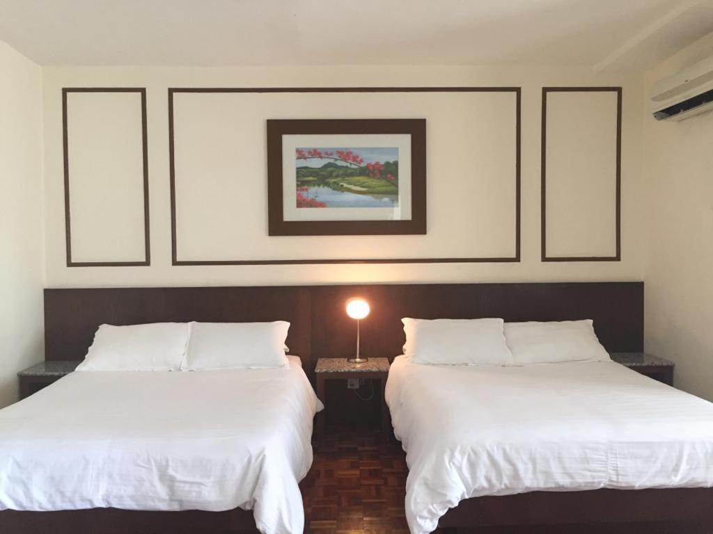 A bed or beds in a room at D savoy @ Famosa by MR