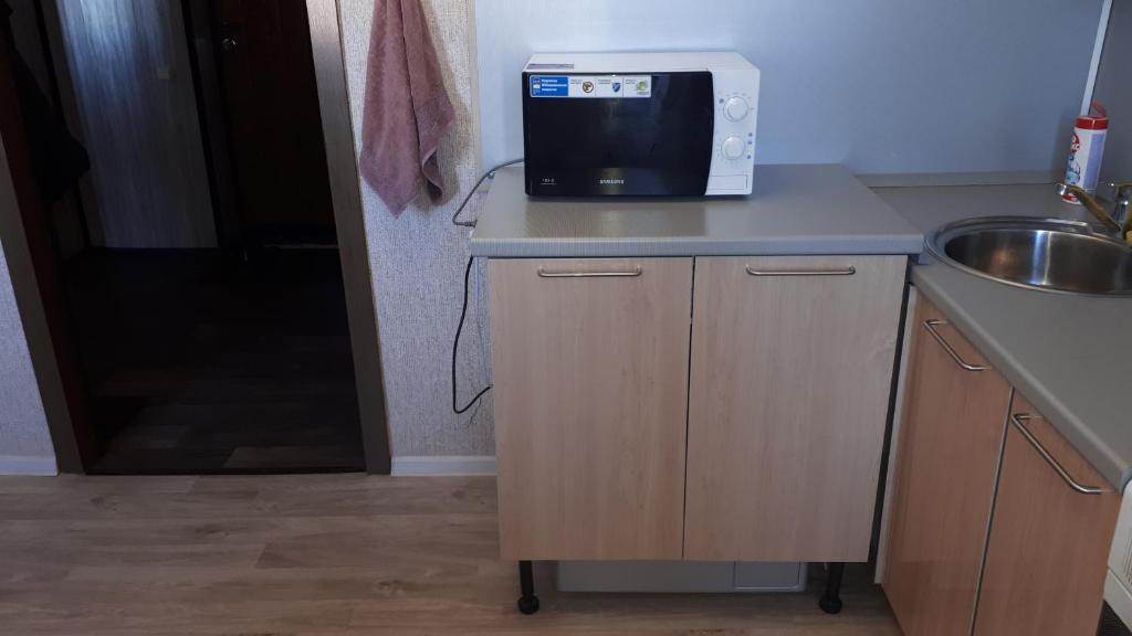Телевизор и/или развлекательный центр в Уютная квартира