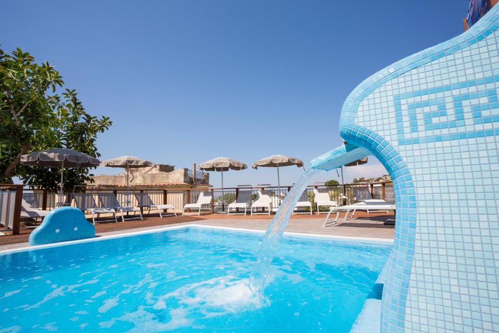 The swimming pool at or close to IL SOFFIO DI TIFEO - RESORT