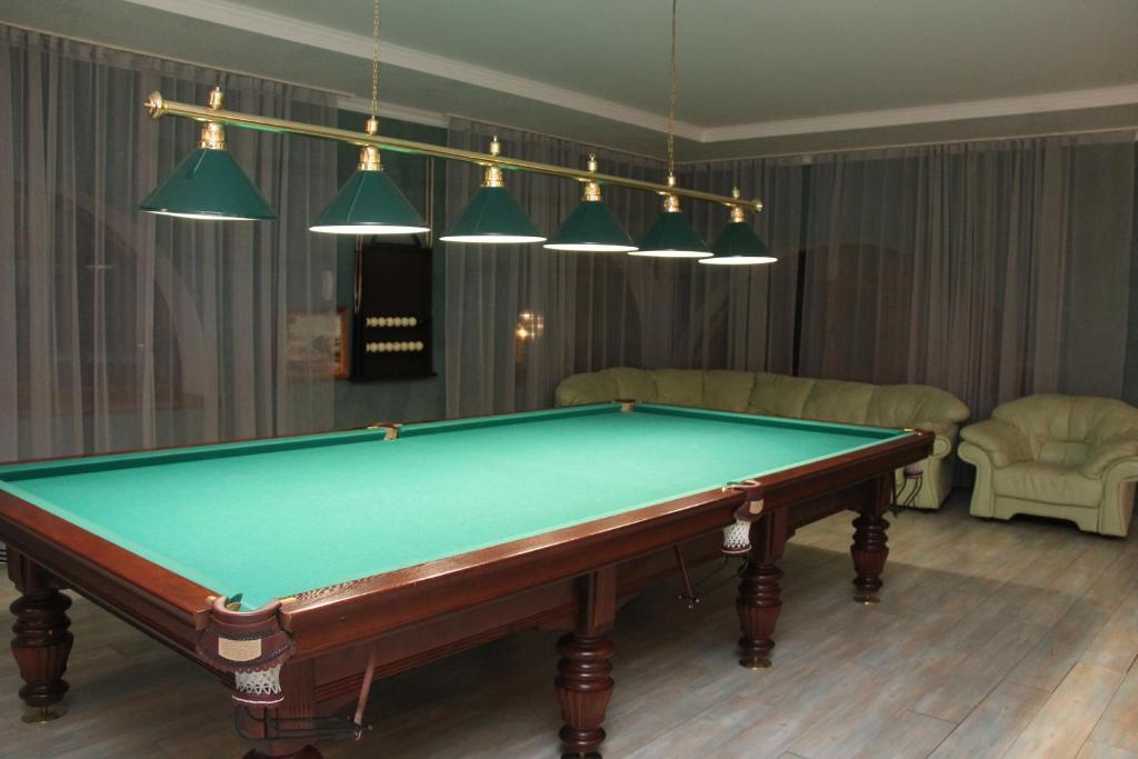 A pool table at Лесная Поляна Отель