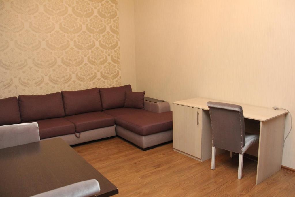 A seating area at Лесная Поляна Отель