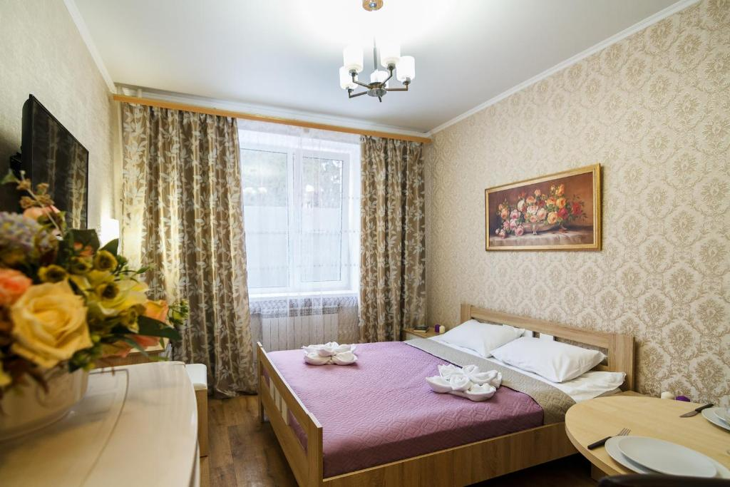 A bed or beds in a room at Guest House Tomilino