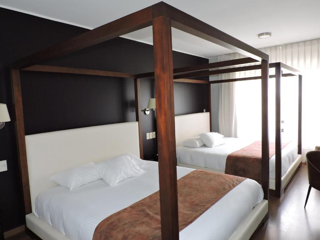 En eller flere køyesenger på et rom på Regency Park Hotel + Spa