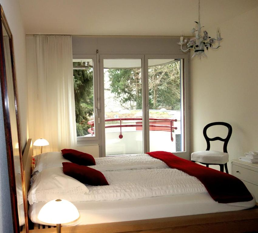 A bed or beds in a room at Exclusive Central Apartment