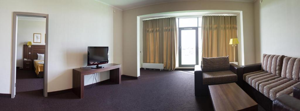A television and/or entertainment center at Zolotoy Zaton Business hotel